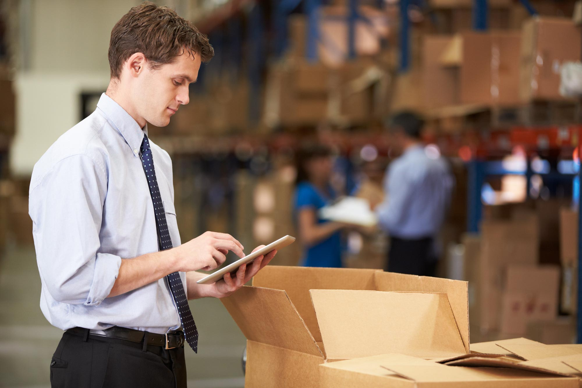 Manager-In-Warehouse-Checking-Boxes-Using-Digital-Tablet22.jpg