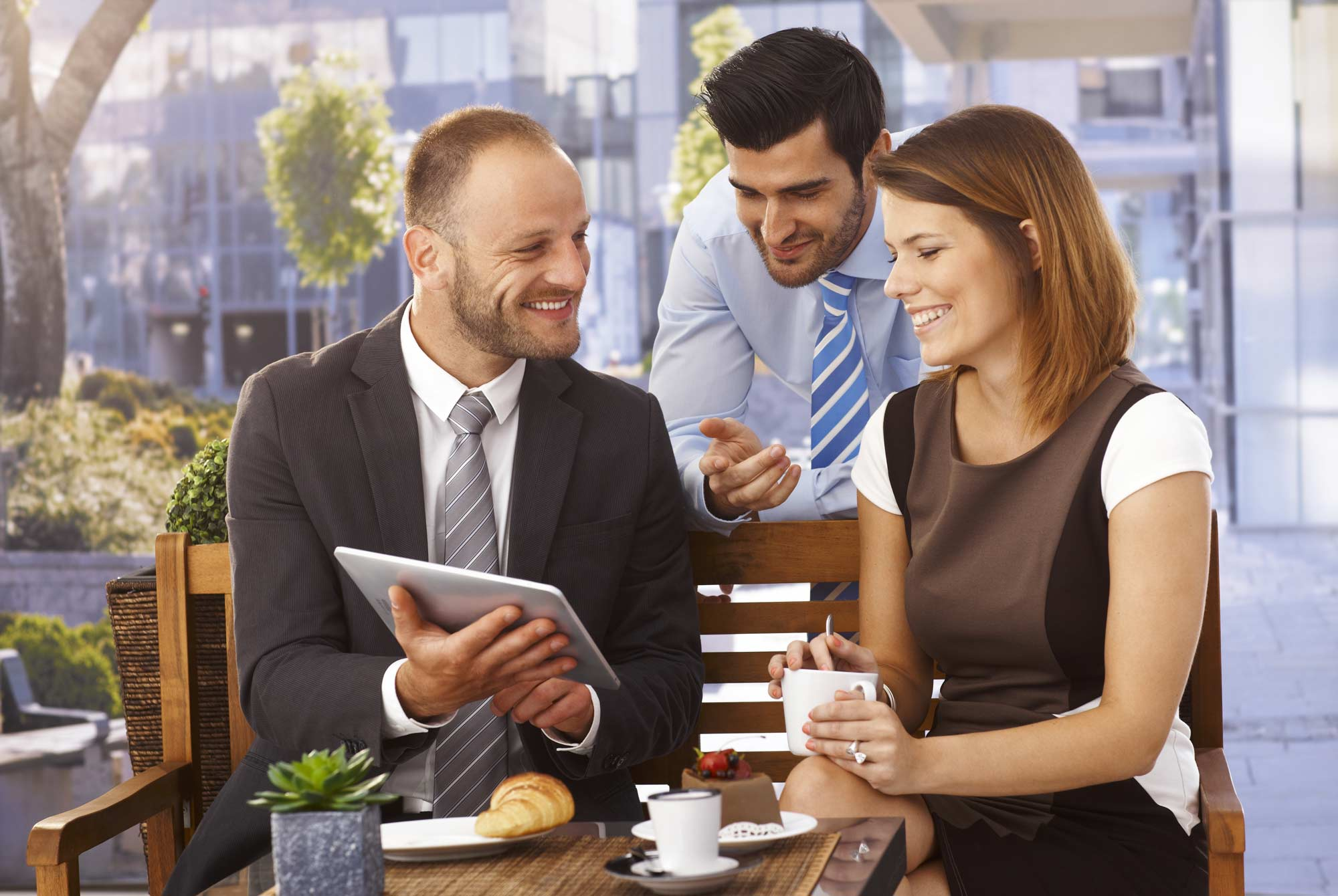 business-team-having-outdoor-meeting-using-tablet-39009572.jpg